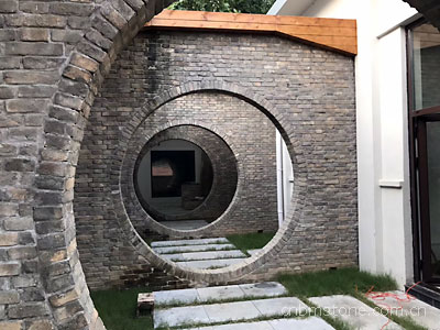 Chinese brick wall with round door way